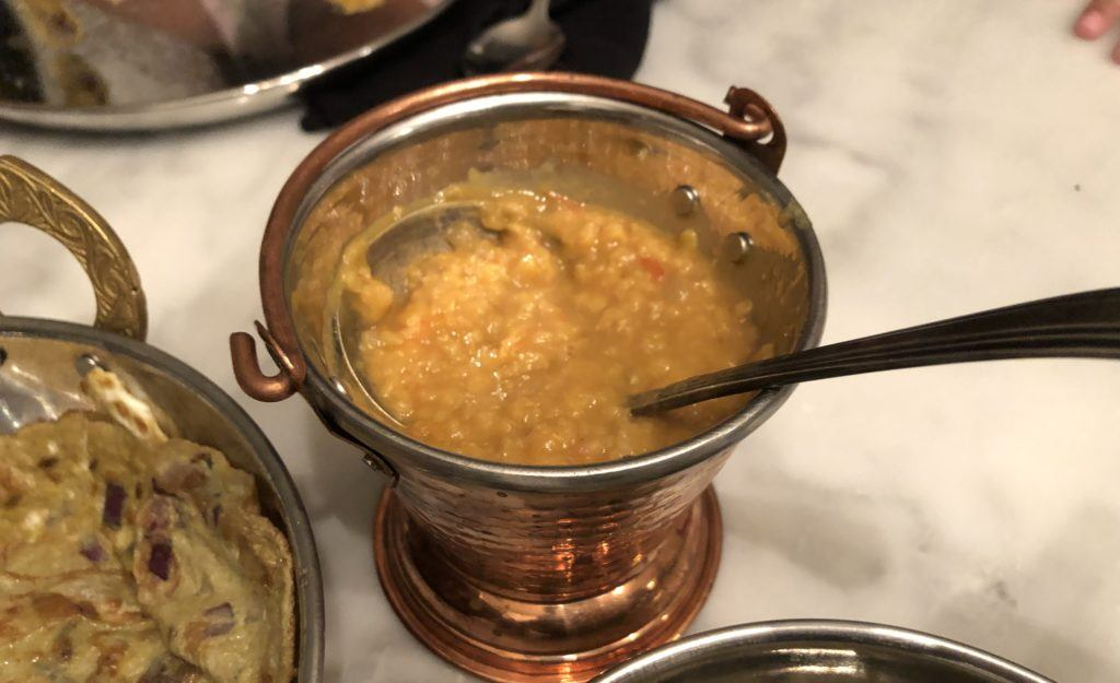 meghnas tomato pappu in a tradtiional copper serving pot