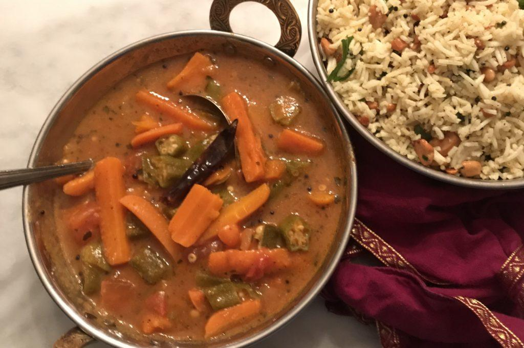 souped up sambhar and lemon rice in traditional indian bowls