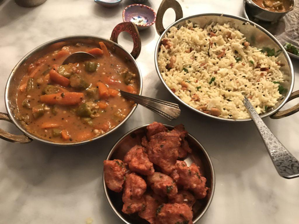 chicken 65, lemon rice and sambhar in traditional indian serving dishes