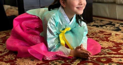 korean new year, child in a hanbok, paying tribute to elders