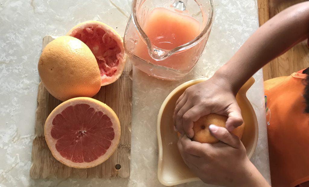 little hands to help make fresh grapefruit juice