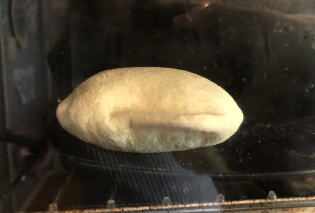 fresh, homemade pita baking and puffing up in the oven.