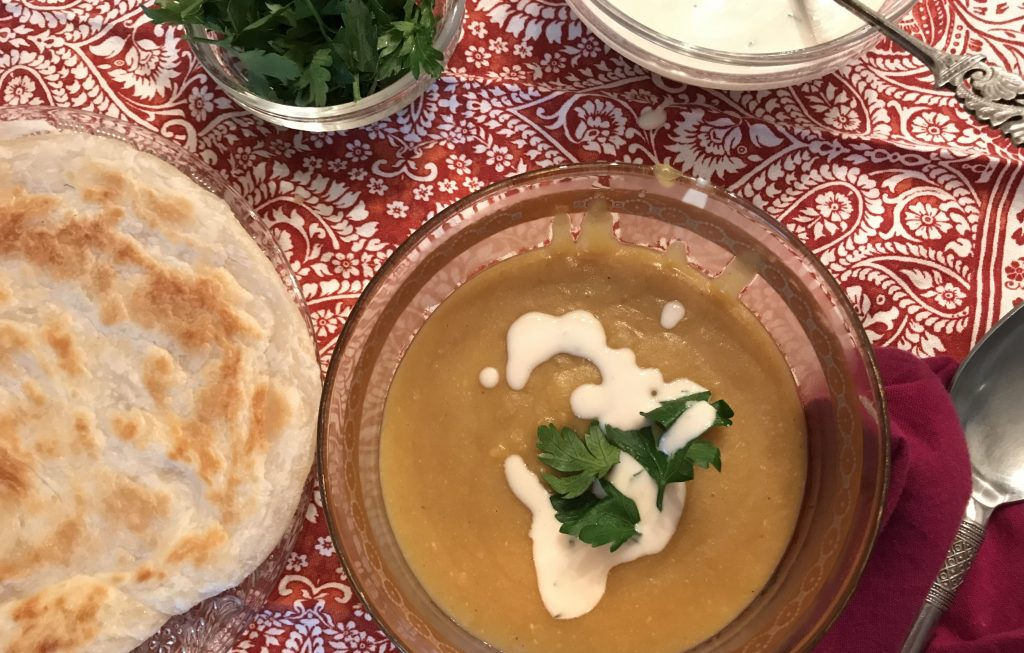 shorbet adas, with bread, tahini sauce and parsley.