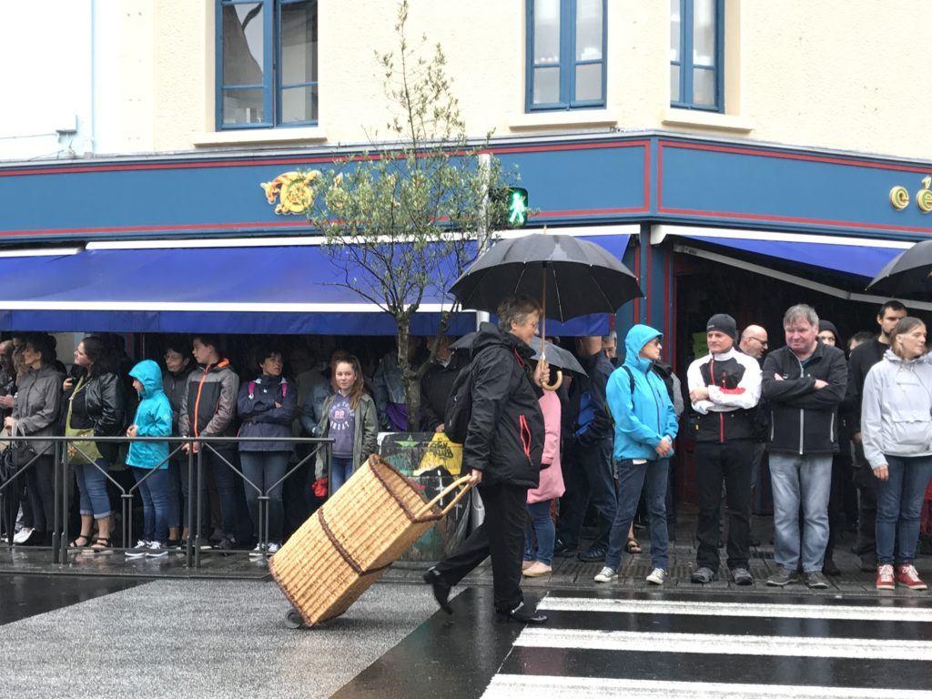 festival de cornouaille and the umbrella carrier for the parade