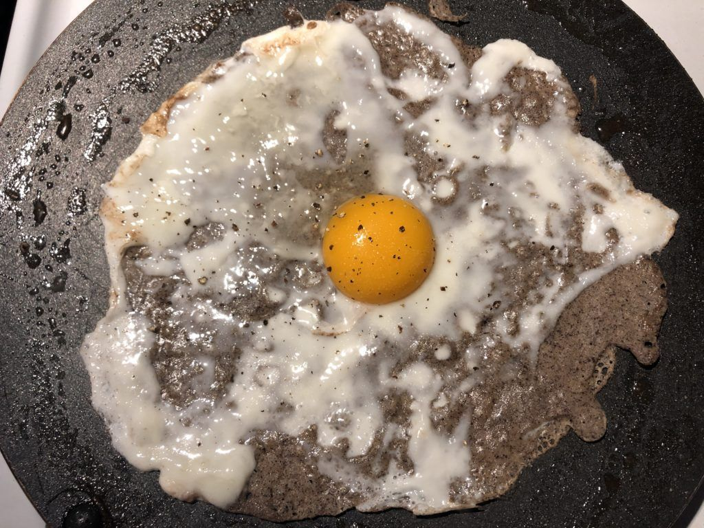 buckwheat crepe with egg as it cooks