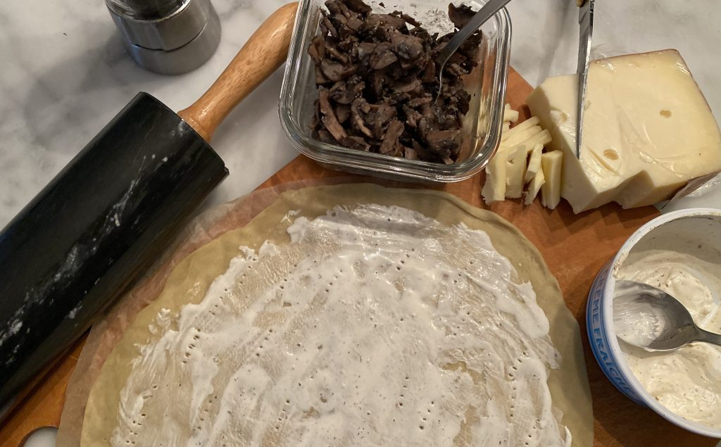 getting tarte flambée ready for it's first time in the oven