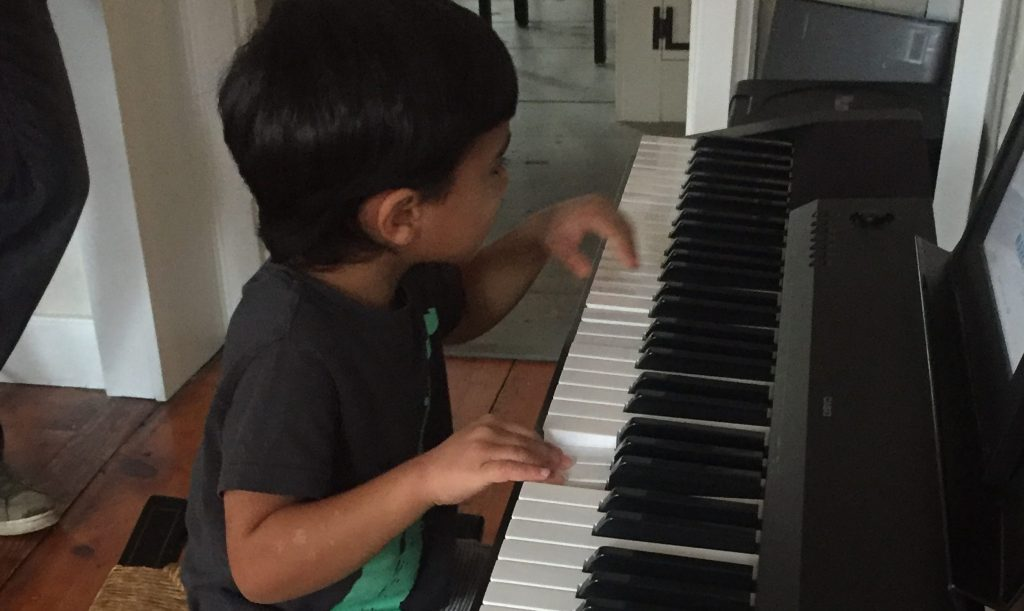 toddler on full piano