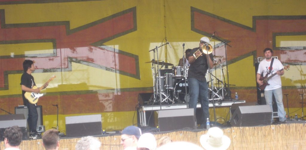Big Sam, at Jazz fest 2010 before he bent up his 'bone, Dizzy-style.