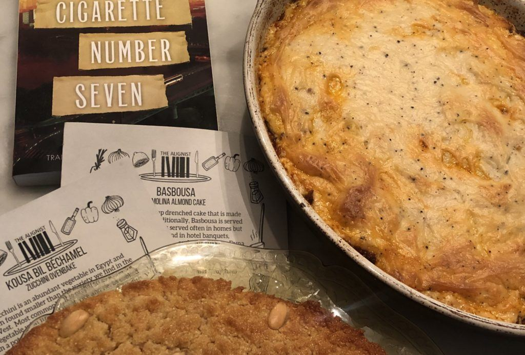 novel cigarette number seven along side two dishes made according to the subscription box by the alignist