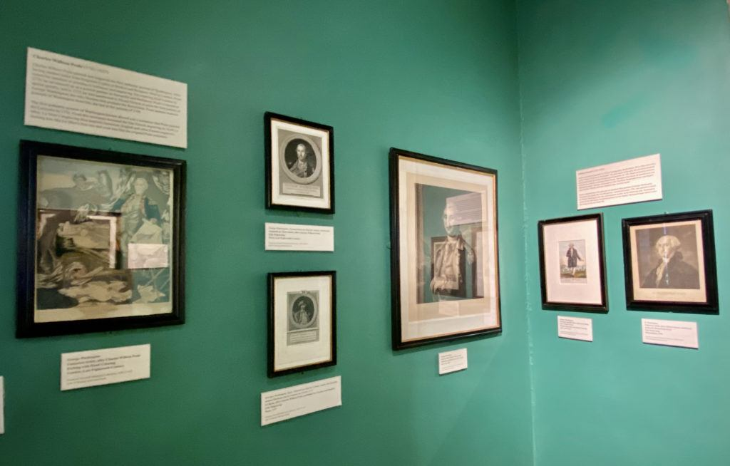 some of the many portaits of washington collected at the fraunces tavern museum